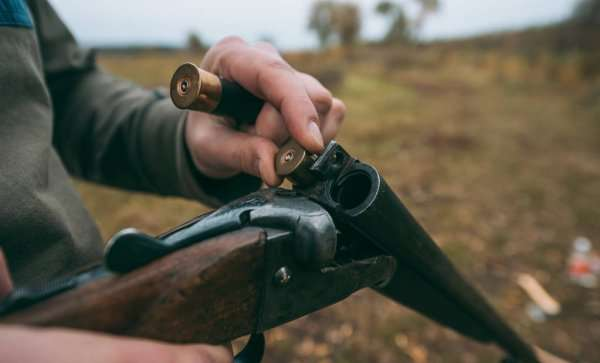 depositphotos_170904672-stock-photo-hunter-loading-gun-with-bullets